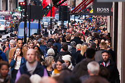 "London, December 23rd 2014. Dubbed by retailers as the ""Golden Hour"" thousands of shoppers use their lunch hour to do some last minute Christmas shopping in London's West End. PICTURED: Thousands of shoppers cram up-market Regent Street."