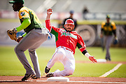 SAN JUAN, PUERTO RICO FEBRUARY 2: A player for Mexico is safe at third base during the game against Cuba on February 2, 2015 in San Juan, Puerto Rico at Hiram Bithorn Stadium(Photo by Jean Fruth)