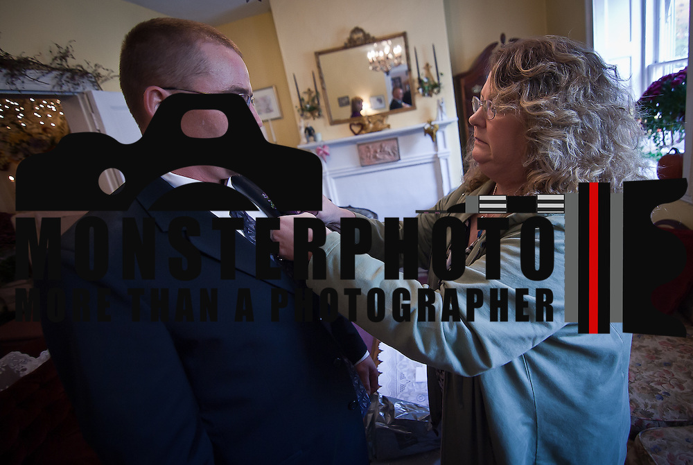 11/11/11 Elkton MD: Laura Shipkowski (Right) pins a Boutineer on her nephew William M. Stevens of New Castle Delaware before his wedding ceremony Friday, Nov. 11, 2011 at Elkton Wedding Chapel in Elkton Maryland...Special to The News Journal/SAQUAN STIMPSON