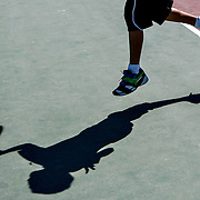 Aaron Reyes, 9, returns a ball while playing tennis with his father Enoc Reyes on Monday at Highlands Grange Park in Kennewick. They were enjoying the weather with some tennis practice on their last day of visiting from Mexico. Enoc's sister Elsa Vazquez lives Kennewick. Expect mostly sunny conditions today with highs around 80, according to the National Weather Service.