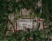 """Here a campaign poster of Jose Luis Abarca, the former mayor of Iguala who ordered the attack on the students, on a abandoned building in Iguala. The sign's campaign slogan reads """"closer to you."""" Abarca has since been arrested and has been charged with, among other things, links to organized crime."""
