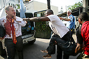 Three injured persons, one Belgian and two Congolese, arrive at the emergency unit of the United Nations Organization Mission in the Democratic Republic of the Congo (MONUC) Headquarters, in Kinshasa, after they're rescued by Bangladeshi MONUC Police FPU. 22 March 2007<br /> Photo by Martine Perret/
