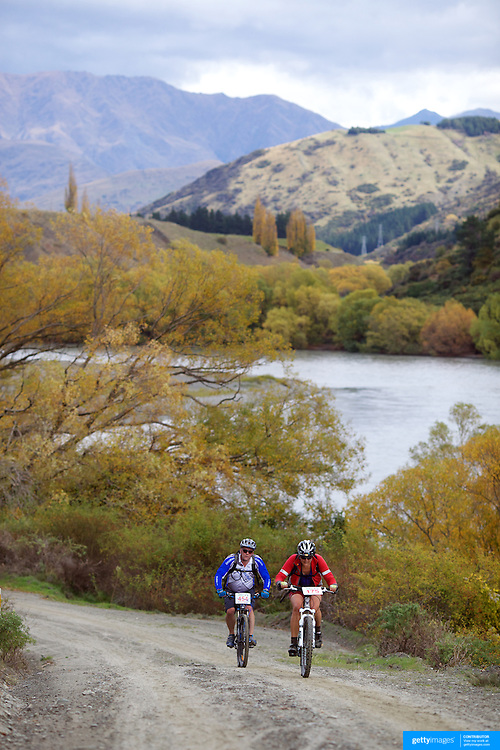 Paul Withers (left) and Marg Balogh in action during the New World Tour de Wakatipu bike race on Saturday. Six hundred and ninety people entered the bike race which featured an  exclusive course with breathtaking views from Millbrook Resort in Arrowtown to Chard Farm along the Kawarau River, via the trails and tracks of the Wakatipu basin with distances of 36 kilometres fun riding for recreational bikers and 45 kilometres for elite and sport racers. The event was part of the inaugural Queenstown Bike Festival, which took place from 16th-25th April. The event hopes to highlight Queenstown's growing profile as one of the three leading biking centres in the world. Queenstown, Central Otago, New Zealand. 23rd April 2011. Photo Tim Clayton..