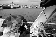 Muslim tourists doing a cruise on the Bosphorus, in Istanbul.