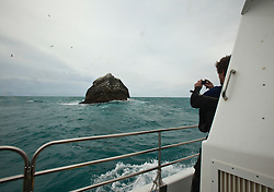 Nick Hancock (yellow dry suit), on his reconnaissance mission for a future 60 day occupation of Rockall, an extremely small, uninhabited, remote rocky islet in the North Atlantic Ocean. .The Rockall Jubilee Expedition, a unique endurance expedition to be undertaken by Nick, in order to raise funds for Help for Heroes.