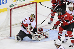 Apr 7; Newark, NJ, USA; Ottawa Senators goalie Craig Anderson (41) makes a save on a shot by New Jersey Devils center Travis Zajac (19)  during the third period at the Prudential Center. The Devils defeated the Senators 4-2.