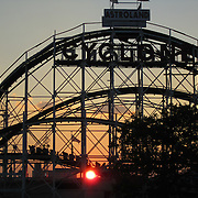 Sunset over Cyclone roller coaster as seen from Coney Island in Brooklyn, New York. National Historic Landmark!