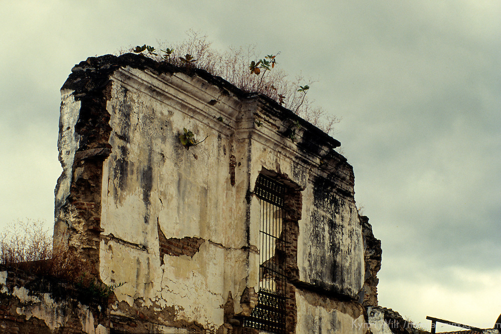 Central America, Guatemala, Antigua. Remaining wall of earthquake damage in Antigua.