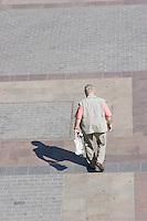 Man Walking on the Rynek in Krakow Poland