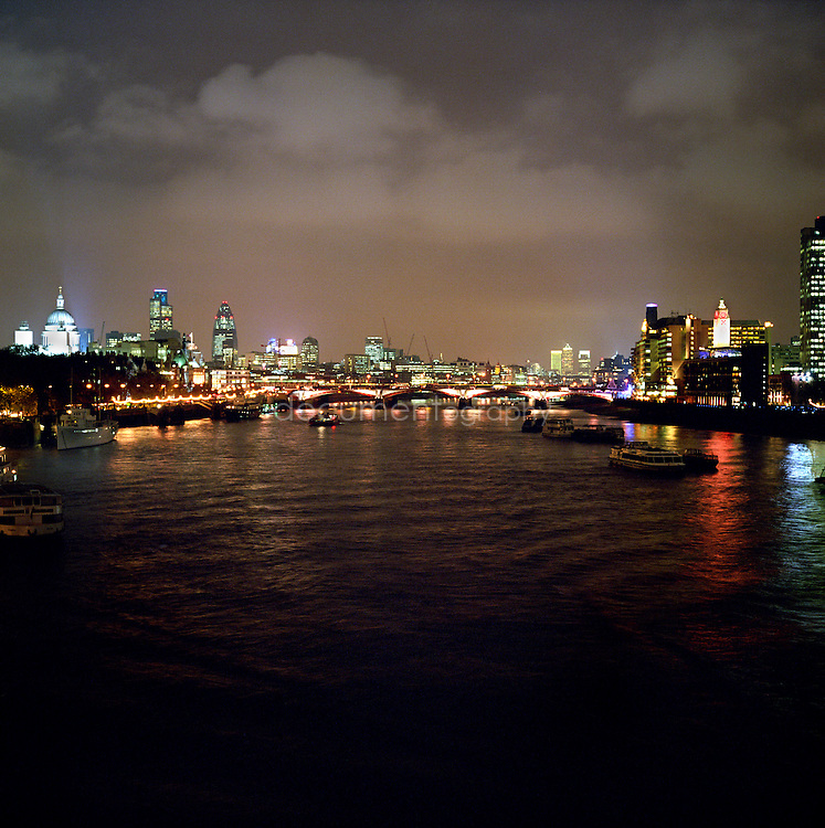 The Thames river at night, London, UK.