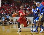 "Ole Miss guard Trevor Gaskins (23)  dribbles against Kentucky's Brandon Knight (12) at the C.M. ""Tad"" Smith Coliseum in Oxford, Miss. on Tuesday, February 1, 2011. Ole Miss won 71-69."