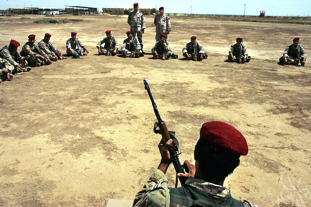 10th Division, 4th Brigade Iraqi army soldiers receive ak-47 training  at the Sparrow Hawk base outside al-Amarah, Iraq May 27, 2006.