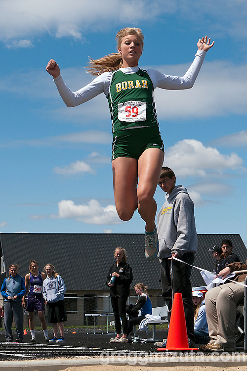 "Borah senior Brittany Owens soars to a meet record 20-00.25"" long jump during the YMCA Track and Field Invite on April 28, 2012 at Rocky Mountain High School, Meridian, Idaho. The mark is the seventh longest high school jump in the nation for 2012 and easily exceeded her state meet record of 19-01.00 set in 2010."