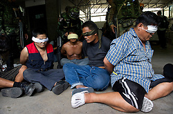 Red-shirt anti-government protesters are detained by Thai soldiers inside their camp in Bangkok during military crackdown to end the Red-shirt protests.