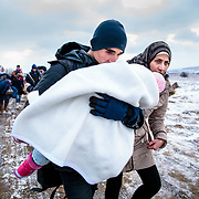 After crossing the Macedonian-Serbian border, refugees walk the unofficial refugee route in subfreezing snowy weather. Near Miratovac, Serbia, January 17, 2016. <br /> <br /> According to UNHCR, 67,415 refugees landed in Greece in January 2016, most of who traveled the route through Serbia on their way to Western Europe. The number of refugees arriving in Greece has dropped significantly since the Balkan border closures in March 2016.<br /> <br /> Produced for Mercy Corps.