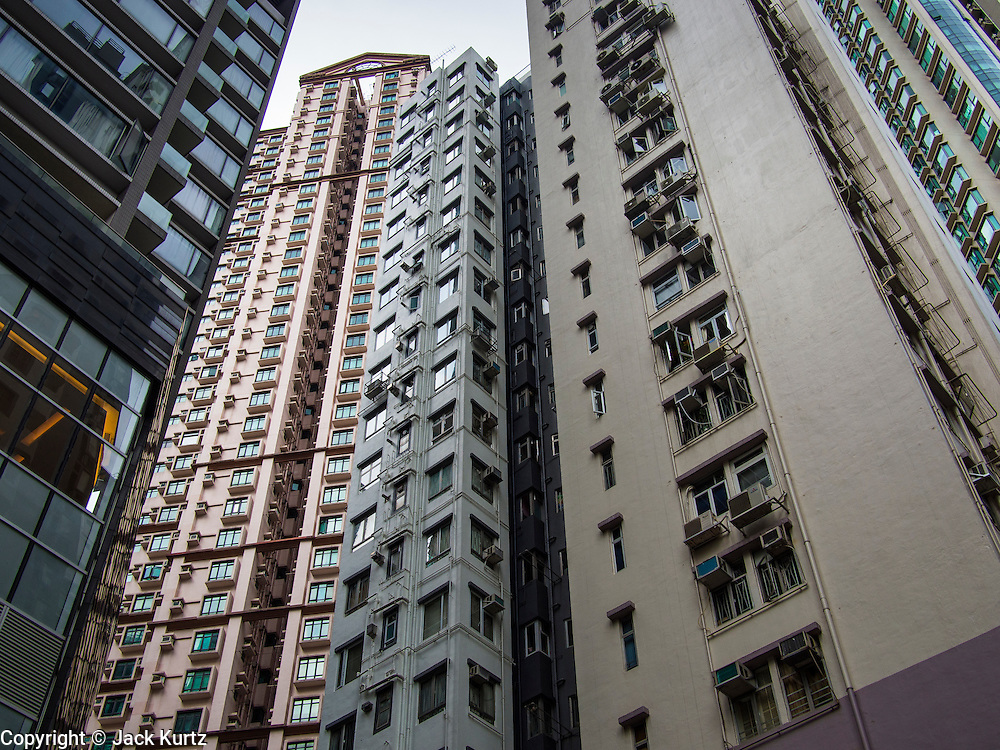 10 AUGUST 2013 - HONG KONG: Apartment buildings on the island of Hong Kong. Hong Kong is one of the two Special Administrative Regions of the People's Republic of China, Macau is the other. It is situated on China's south coast and, enclosed by the Pearl River Delta and South China Sea, it is known for its skyline and deep natural harbour. Hong Kong is one of the most densely populated areas in the world, the  population is 93.6% ethnic Chinese and 6.4% from other groups. The Han Chinese majority originate mainly from the cities of Guangzhou and Taishan in the neighbouring Guangdong province.      PHOTO BY JACK KURTZ