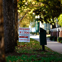 CELEBRATION, FL -- December 2, 2010 -- A reward sign is posted outside of the crime scene of a murder in the small, Disney master-planned community in Celebration, Fla., on December 2, 2010.  The town's first murder in its 14 year existence has drawn buzz worldwide and amongst its citizens alike.