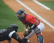 Ole Miss catcher Stuart Turner (26) blocks the ball as Lipscomb's Aaron Sandoval (29) scores at Oxford-University Stadium in Oxford, Miss. on Sunday, March 10, 2013. Ole Miss won 9-8. The Rebels improve to 16-1.