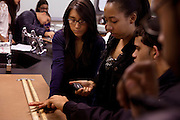From left, Elvira Quintero, 17, Kayla Perdomo, 17, Derick Estrella, 17 and Eric Hamilton, 16, during Physics lab at Central Park East High School in New York, NY on November 15, 2012. Beyond sheer physical safety, a look at how schools and sitricts can create classroom conditions in which students are able to engage enthusiastically and without emotional fear of stepping forward. Photographer: Melanie Burford/Prime