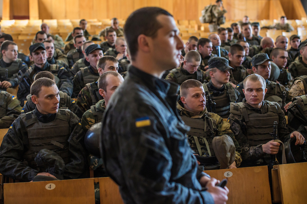 YAVORIV, UKRAINE - APRIL 30, 2015: Ukrainian soldiers debrief after a military training exercise directed by the U.S. Army's 173rd Airborne Brigade as part of Operation Fearless Guardian at the Yavoriv training center near Yavoriv, Ukraine. Around 300 American soldiers are training an equivalent number of Ukrainians during each of three eight-week programs to improve their ability to combat Russian-backed rebels in the country's east. CREDIT: Brendan Hoffman for The New York Times