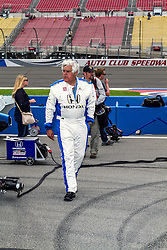 "FONTANA, CA - JUNE 27  Jay Leno host of ""Jay Leno's Garage"" and former host of NBC's ""The Tonight Show attends the 2015 Verizon IndyCar MAVTV 500 as a guest of racing legend Mario Andretti of Andretti Autosport. Jay took a two lap ride in a two seater indycar with andretti as part of the pre-race activies. 2015 June 27. 2015 June 26. Byline, credit, TV usage, web usage or linkback must read SILVEXPHOTO.COM. Failure to byline correctly will incur double the agreed fee. Tel: +1 714 504 6870."