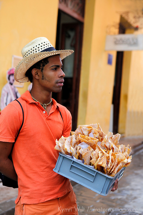 Central America, Cuba, Havana. Cuban vendor sells crispy cinammon tortilla chips on the street in Old Havana.
