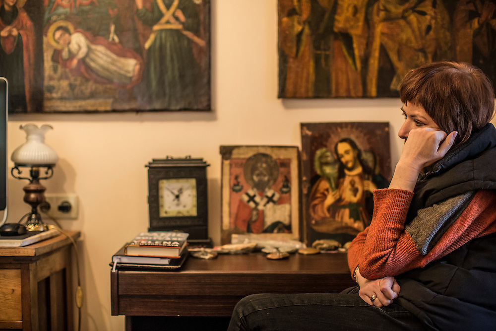 ODESSA, UKRAINE - MARCH 26, 2015: Ludmilla Khersonskaya, wife of poet Boris Khersonsky, listens as he is interviewed in his home office in Odessa, Ukraine. CREDIT: Brendan Hoffman for The New York Times