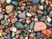 """Lake Michigan waves have tumbled and smoothed colorful pebbles into rounded shapes at Pictured Rocks National Lakeshore on the Upper Peninsula of Michigan, USA. The scenic park includes the hilly shoreline between Munising and Grand Marais, Michigan. Published in """"Light Travel: Photography on the Go"""" by Tom Dempsey 2009, 2010."""