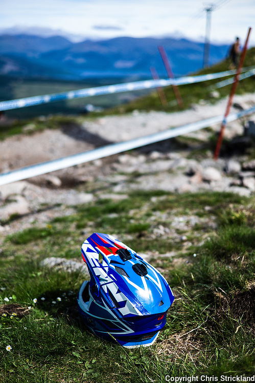 Nevis Range, Fort William, Scotland, UK. 3rd June 2016. A helmet on trackside while a rider makes some running repairs. The worlds leading mountain bikers descend on Fort William for the UCI World Cup on Nevis Range. © Chris Strickland / Alamy Live News