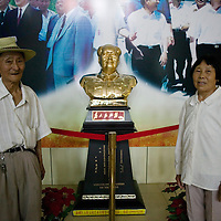 SHIHEZI, JULY-16 : Zhang Jijun, 78, who came to Shihezi from Sichuan Province with her husband.  (He didn't give his name.)