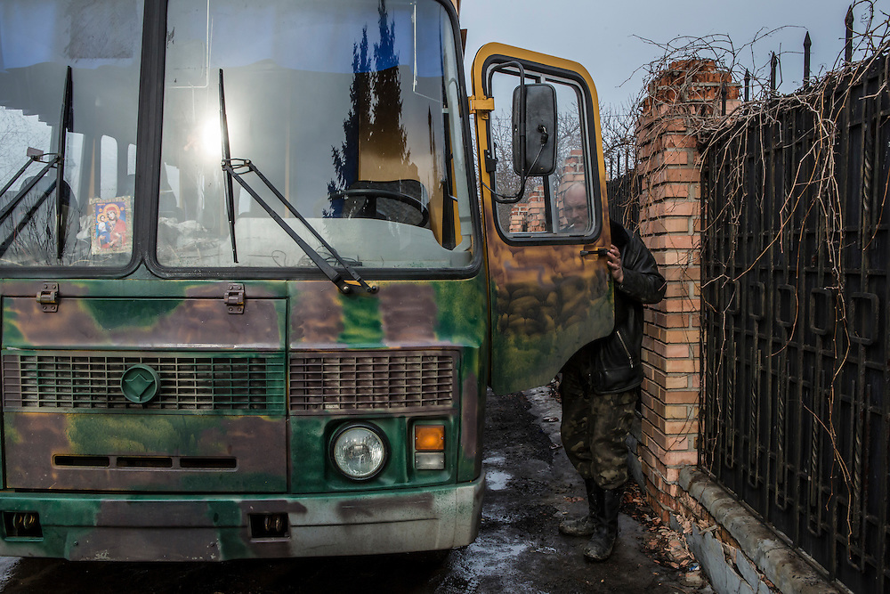 GORLOVKA, UKRAINE - JANUARY 31, 2015: A rebel with a bus used to transport fighters near the front lines in Gorlovka, Ukraine. Fighting in Ukraine has intensified over the last week, with rebels declaring the end of a September ceasefire. CREDIT: Brendan Hoffman for The New York Times