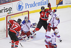 May 21, 2012; Newark, NJ, USA; New York Rangers goalie Henrik Lundqvist (30) makes a save on New Jersey Devils left wing Ilya Kovalchuk (17) while New Jersey Devils right wing Dainius Zubrus (8) and New York Rangers defenseman Dan Girardi (5) battle during the first period in game four of the 2012 Eastern Conference Finals at the Prudential Center.