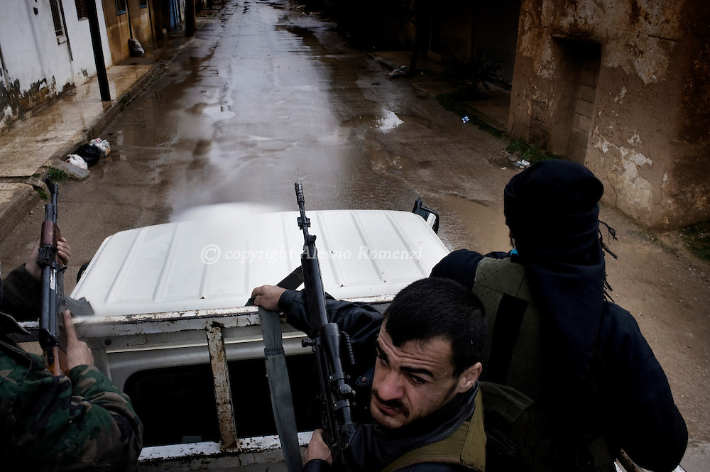 SYRIA - Al Qsair. Members of Free Syrian Army in Al Qsair, on January 27, 2012. Al Qsair is a small town of 40000 inhabitants, located 25Km south-west of Homs. The town is besieged since the beginning of November and so far it counts 65 dead. ALESSIO ROMENZI