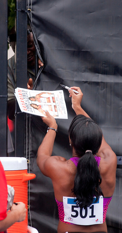 Toronto, Ontario ---10-07-31---  Perdita Felicien signs autographs following her win in the 100 metre hurdles at the 2010 Canadian Track and Field Championships in Toronto, Ontario July 31, 2010.<br />  GEOFF ROBINS/Mundo Sport Images