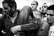 Munib Masri being helped by civil defense volunteers. The Lebanese army said that 10 protesters died due to gunshot wounds by the Israeli army and 112 were wounded.Tens of thousands of Palestinians and their supporters gathered at the border town of Maroun Al Rass to commemorate 63 years since the Nakba or catastrophe. Palestinians commemorate on May 15 the loss of their homeland.  Maroun Al Rass, Lebanon, May 15, 2011. OMAR YASHRUTI