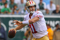 Sept 30, 2012; East Rutherford, NJ, USA; San Francisco 49ers quarterback Alex Smith (11) throws a pass during the first half of their game against the New York Jets at MetLIfe Stadium.