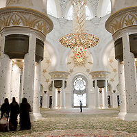 Abu Dhabi, United Arab Emirates 07 April 2009<br /> Sheikh Zayed Mosque in Abu Dhabi is the largest mosque in the United Arab Emirates and the sixth largest mosque in the world. <br /> It is named after Sheikh Zayed bin Sultan Al Nahyan, the founder and the first President of the United Arab Emirates, who is also buried there. The Mosque is large enough to accommodate 40,000 worshippers. The main prayer hall can accommodate up to 9,000 worshippers. Two rooms next to the main prayer hall, with a 1,500-capacity each, are for the exclusive use of women.<br /> Photo: Ezequiel Scagnetti