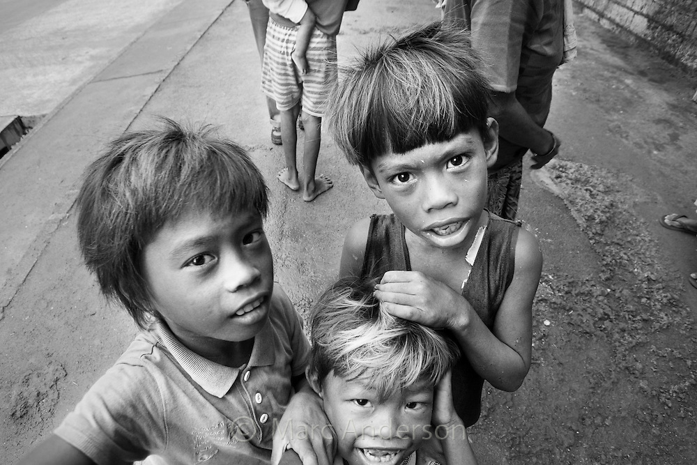 Children begging on a street, Tagbilaran, Bohol, Philippines..