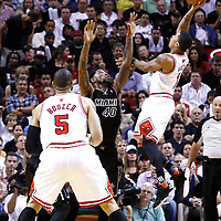 29 January 2012: Chicago Bulls point guard Derrick Rose (1) goes for the floater over Miami Heat power forward Udonis Haslem (40) during the Miami Heat 97-93 victory over the Chicago Bulls at the AmericanAirlines Arena, Miami, Florida, USA.