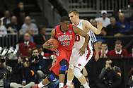 Ole Miss' Reginald Buckner (23) vs. Wisconsin's Jared Berggren (40) in the NCAA Tournament at the Sprint Center in Kansas City, Mo. on Friday, March 22, 2013.