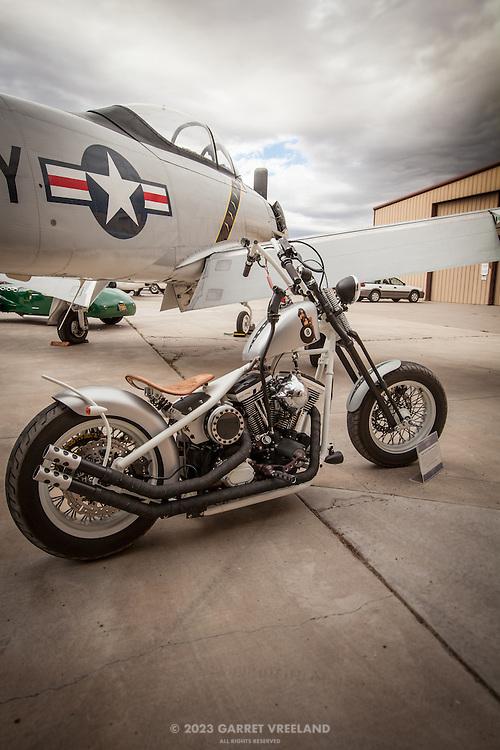 Custom motorcycle and T-28, Planes and Cars at the Santa Fe Airport, 2013 Santa Fe Concorso.