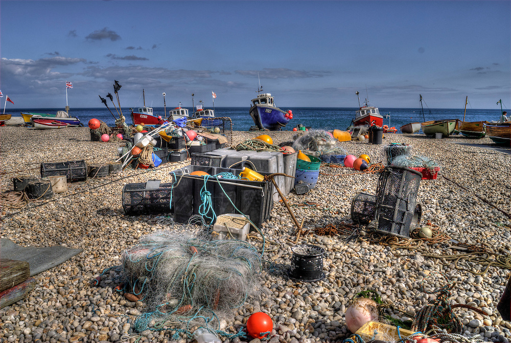 The beach at Beer, a busy fishing harbour in South Devon, England.  Only small fishing boats can launch here as they need to be winched up the shingle beach after each fishing trip.