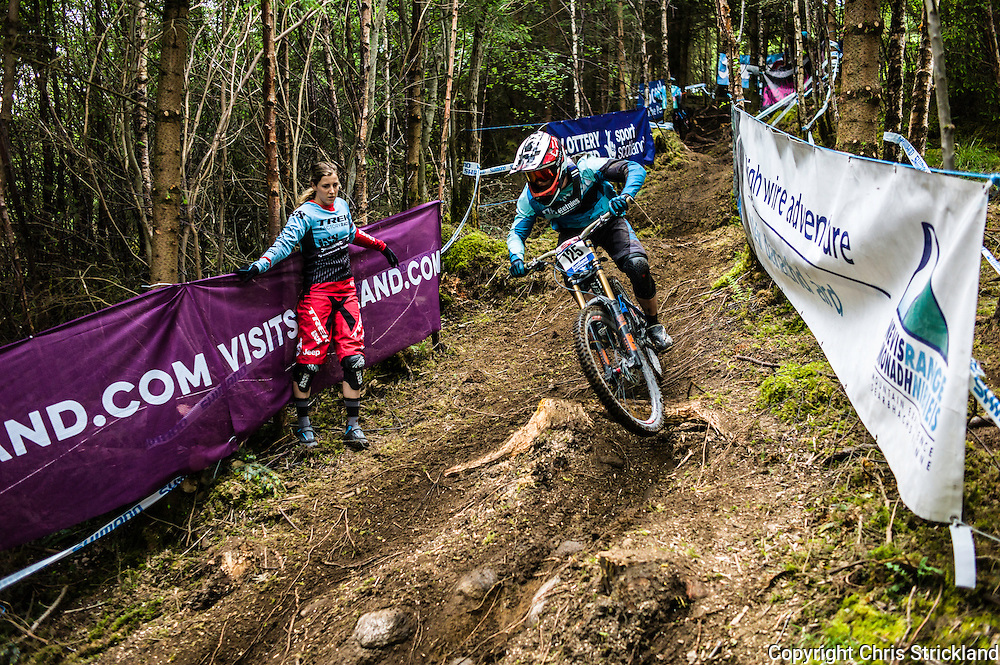 Nevis Range, Fort William, Scotland, UK. 4th June 2016. Rachel Atherton inspects the course in the wooded section during practice. The worlds leading mountain bikers descend on Fort William for the UCI World Cup on Nevis Range.