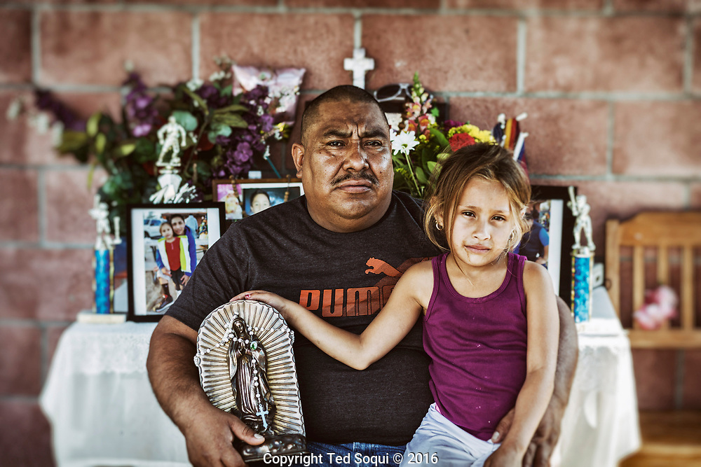 Juan along with his daughter are holding an urn with his son's ashes.<br /> His son Jose was shot 17 times and killed by LAPD officers on Feb. 6, 2016.