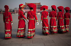Stewardesses in ethnic minority costumes walk in Tiananmen square before the opening session of the National Peoples Congress (NPC) at the Great Hall of the People in Beijing, China, on 05 March 2011. The NPC has over 3,000 delegates and is the world's largest parliament or legislative assembly though its function is largely as a formal seal of approval for the policies fixed by the leaders of the Chinese Communist Party.