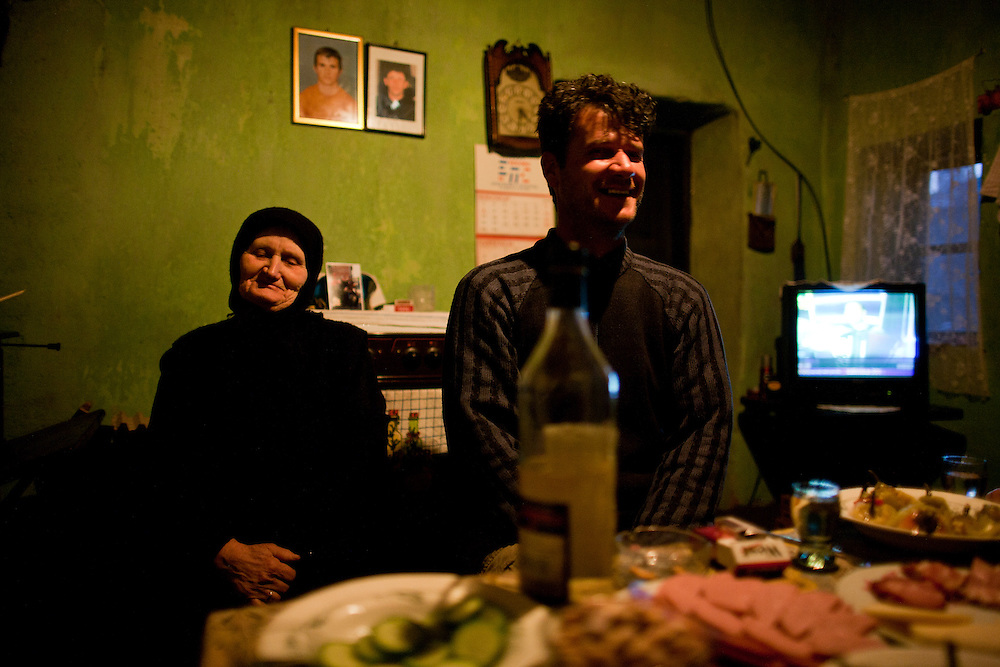 Zivana Pavlovic in her home in Velika Hoca. Her younger son Nebojsa was abducted and killed during the war and is survived by his older brother Slavisa...Orthodox Christmas (January 7) in the Serbian village of Velika Hoca, Kosovo.