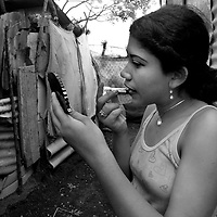 "May 17, 2005 - Managua, Nicaragua -Daniela 17, puts on make up before hitting the streets in downtown Managua to work as an underage prostitute. Daniela, was left by her mom when she was three months old. Her father left her with Meling's (another child prostitute) mother. ""When I came, I came alone. Then I brought Rozievel and Ivania to the house. I'm trying to retire from this, i want to study computers."