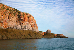 Stunning rock formations near The Sisters in Yampi Sound.  The distinctive tide line seen around the Kimberley coast is visible at low tide.