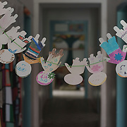 A paper chain drawn by children, hangs in a corridor in Villa Artemis, a shelter for 30 refugee women and their children in the grounds of Leros Hospital. <br /> <br /> Opened in September 2015, the shelter was run by the Leros Solidarity Network. However, Villa Artemis was closed down shortly after the opening of a 'Hotspot' (EU-run migrant's reception centres) camp in Lepida in February 2016.