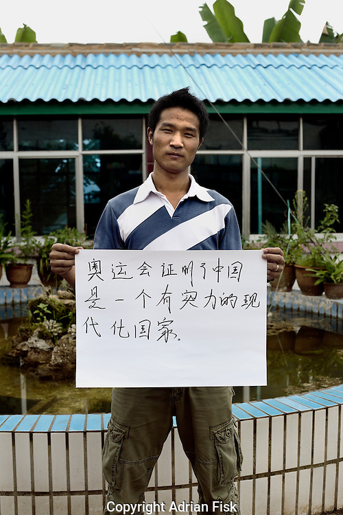 Li Nan Song - 21 Yrs.<br /> Returned home from migrant labour job. Now wants to try and set up business trading local fungus.<br /> Yunnan Province.<br /> <br /> 'The Olympic games proves China is a powerful modern nation'.